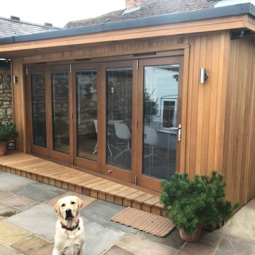 Bespoke garden room with Wedge overhang and deck