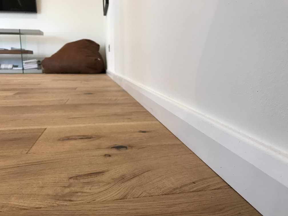 White Skirting Board and Engineered Oak Flooring
